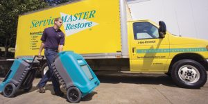 ServiceMaster Restore tech and truck
